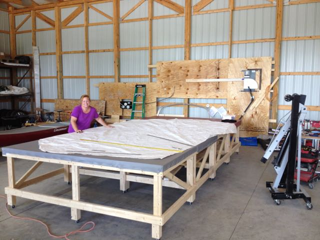 Barbara preparing a pattern for a very large bimini ! Note our frame bending station in the background.