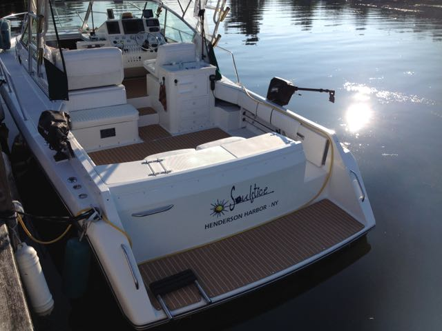 Custom teak AquaMats really make this boat look great! These look like real teak but are actually snap in carpets!
